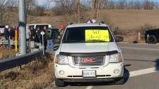 Car with protest sign near Brantford
