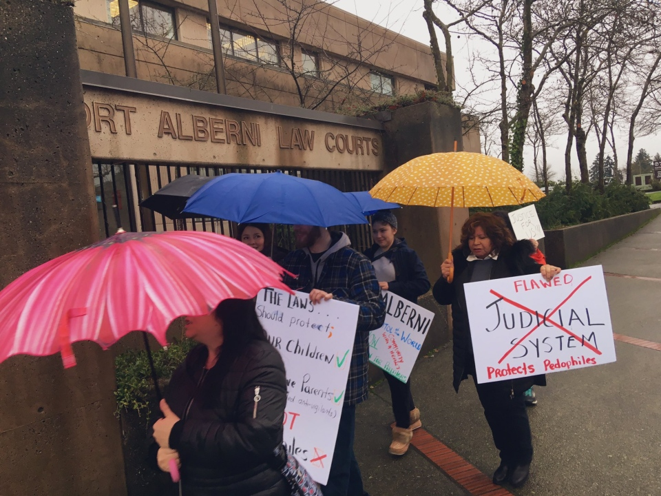 People held signs outside the Port Alberni Courthouse expressing their support for the couple, and their outrage with the decision to charge them. Jan. 11, 2019. (CTV Vancouver Island)