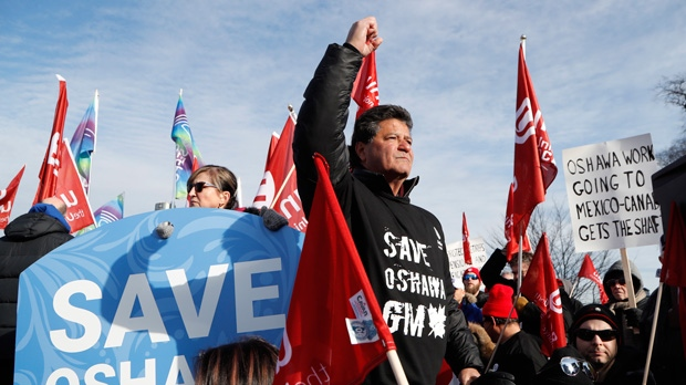 Jerry Dias, the national president for Unifor, the national union representing auto workers, addresses a rally within view of General Motors headquarters, Friday, Jan. 11, 2019, in Windsor, Ont. Workers were protesting the closing of the Oshawa assembly plant, (AP Photo/Carlos Osorio)