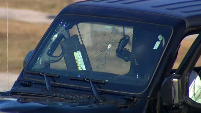 Bullet holes are visible in the windshield of a Jeep police say was involved in a stolen vehicle investigation in Mississauga on January 11, 2019.