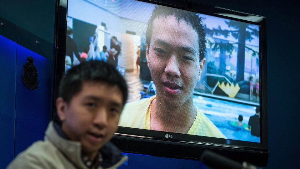 Wilfred Wong speaks about his brother Alfred Wong, 15, seen on a television, who was an innocent victim of an alleged gang shooting, during a Vancouver Police news conference in Vancouver, B.C., on Monday January 22, 2018. THE CANADIAN PRESS/Darryl Dyck