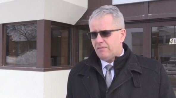 Former Timmins city councillor Rick Dubeau makes a statement outside the courthouse after charges were dropped.