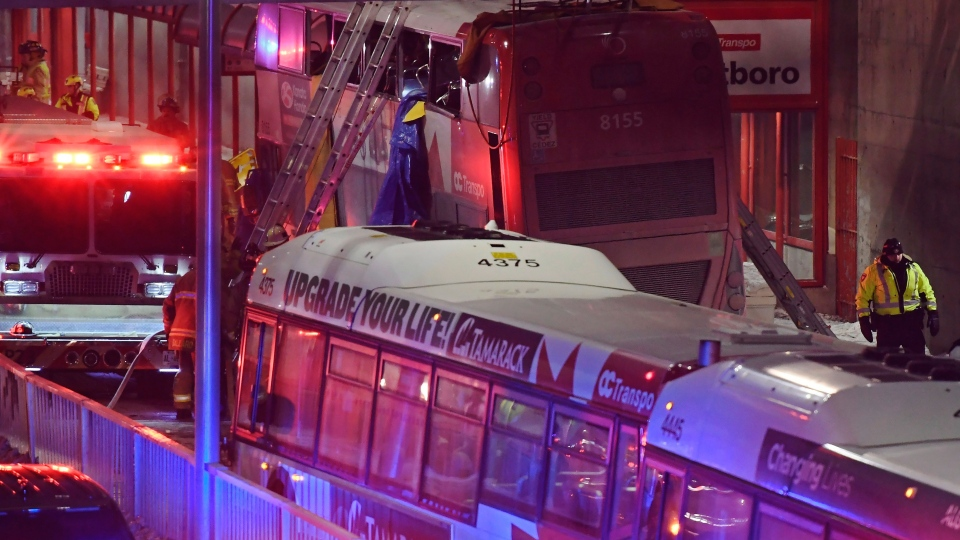 Police and first responders work at the scene where a double-decker city bus struck a transit shelter in Ottawa, on Friday, Jan. 11, 2019. THE CANADIAN PRESS/Justin Tang