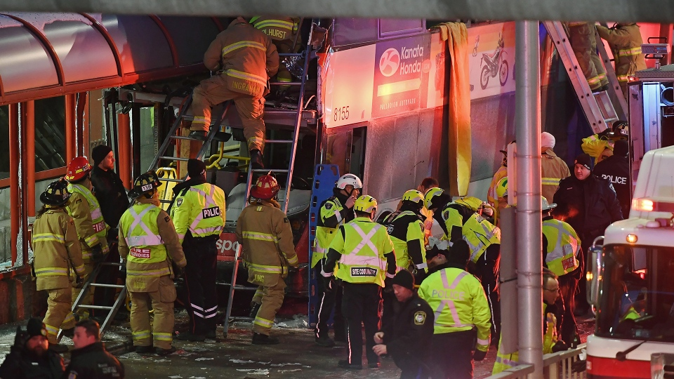 First responders work at the scene where a double-decker city bus struck a transit shelter in Ottawa, on Friday, Jan. 11, 2019. THE CANADIAN PRESS/Justin Tang