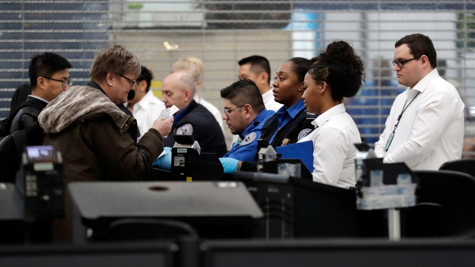 Transportation Security Administration officers work at a checkpoint at O'Hare airport in Chicago, Friday, Jan. 11, 2019, as the partial government shutdown continues. (AP Photo/Nam Y. Huh)