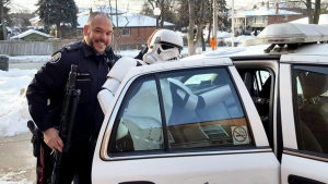 Const. Peter De Quintal is seen in this undated picture with a storm trooper.