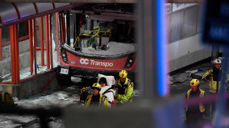 Police and a first responders work at the scene where a double-decker city bus struck a transit shelter in Ottawa, on Friday, Jan. 11, 2019. (THE CANADIAN PRESS/Justin Tang)