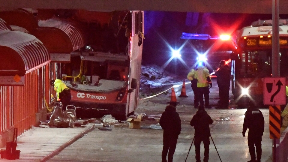 Police and a first responders work at the scene where a double-decker city bus struck a transit shelter in Ottawa, on Friday, Jan. 11, 2019. THE CANADIAN PRESS/Justin Tang