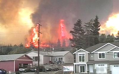 A massive fire continues to rip through a Kelowna, B.C. neighbourhood