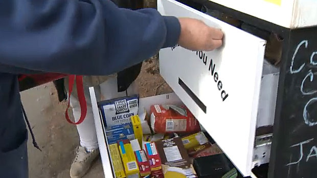 Organizers a free pantry in Forest Lawn invite everyone to come by and either take from or donate to the food storage box.