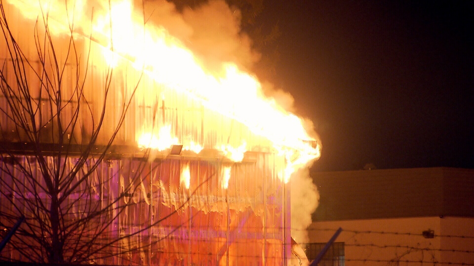 Flames broke out at H & R Towing on 124 Street and 83A Avenue just before 5 a.m. Saturday.