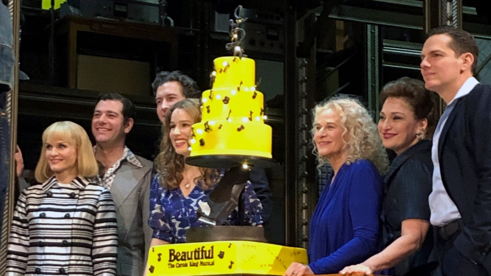 "In this Saturday, Jan. 12, 2019, photo Carole King, third from right, poses for photos with the cast of ""Beautiful: The Carole King Musical"" at the Stephen Sondheim Theatre after a performance in New York. King appeared Saturday night, sitting at a baby grand piano and showing all the love in her heart as she sang ""Beautiful,"" the final song to celebrate the show's fifth anniversary on Broadway. (AP Photo/Brooke Lefferts)"