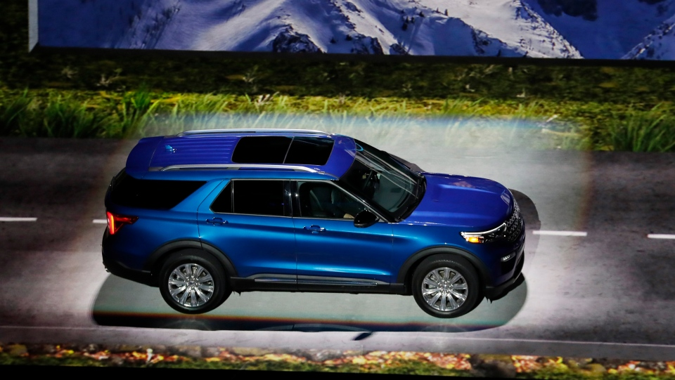In this Wednesday, Jan. 9, 2019 file photo, the 2020 Ford Explorer is unveiled, in Detroit. SUVs and a big pickup truck will get top billing at Detroit's auto show this year, but there are some surprise sports cars and electric vehicles on the agenda. The most popular vehicle of the bunch is the Ford Explorer, revealed ahead of the show Wednesday night at Ford Field, the home of the National Football League's Detroit Lions. (AP Photo/Carlos Osorio, File)