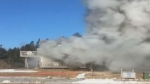A house fire in Spry Harbour, N.S. forced officials to close Highway 7 as they attempted to battle the blaze.