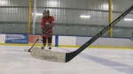 Kids with cognitive challenges take to the ice in Calgary as part of the Super HEROS hockey program. (CTV Calgary)