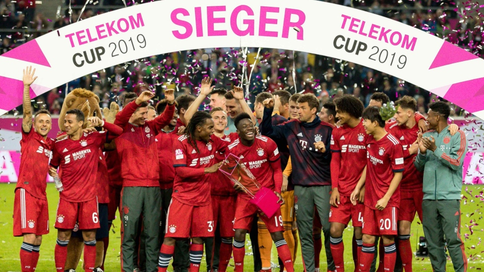 Alphonso Davies old hoisted the Telekom Cup in a sea of confetti after helping Bayern Munich win over Borussia Moenchengladbach. Courtesy: Twitter.com/FCBayernUS