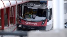 A double-decker city bus that struck a transit shelter at the start of the afternoon rush hour on Friday, remains in place at Westboro Station in Ottawa, on Saturday, Jan. 12, 2019. THE CANADIAN PRESS/Justin Tang