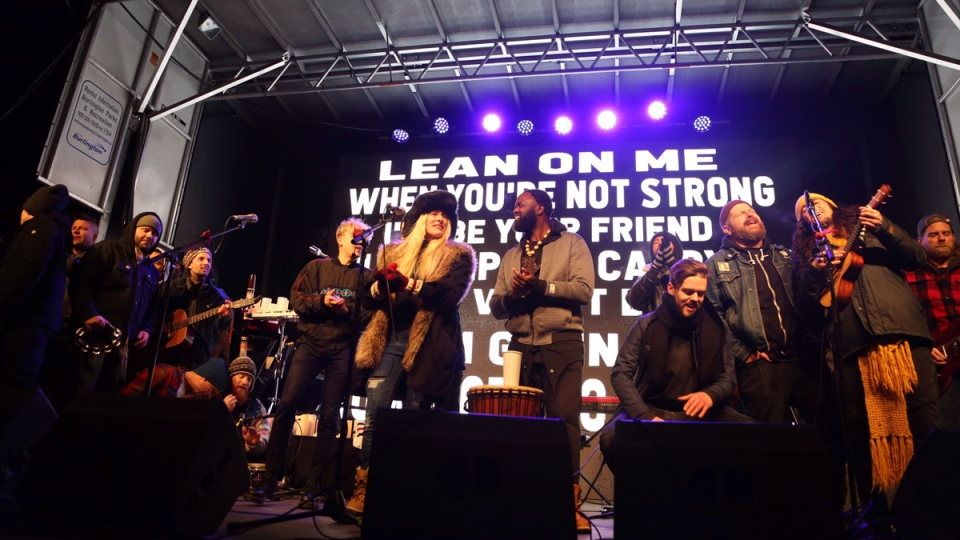Artists who performed during a Walk Off The Earth Memorial & Tribute Concert for Mike 'Beard Guy' Taylor join each other for the finale in Burlington, Ont., on Sunday, January 13, 2019. Acoustic performances by members of Barenaked Ladies, Scott Helman, Monster Truckv and more were also scheduled for the event. THE CANADIAN PRESS/Peter Power