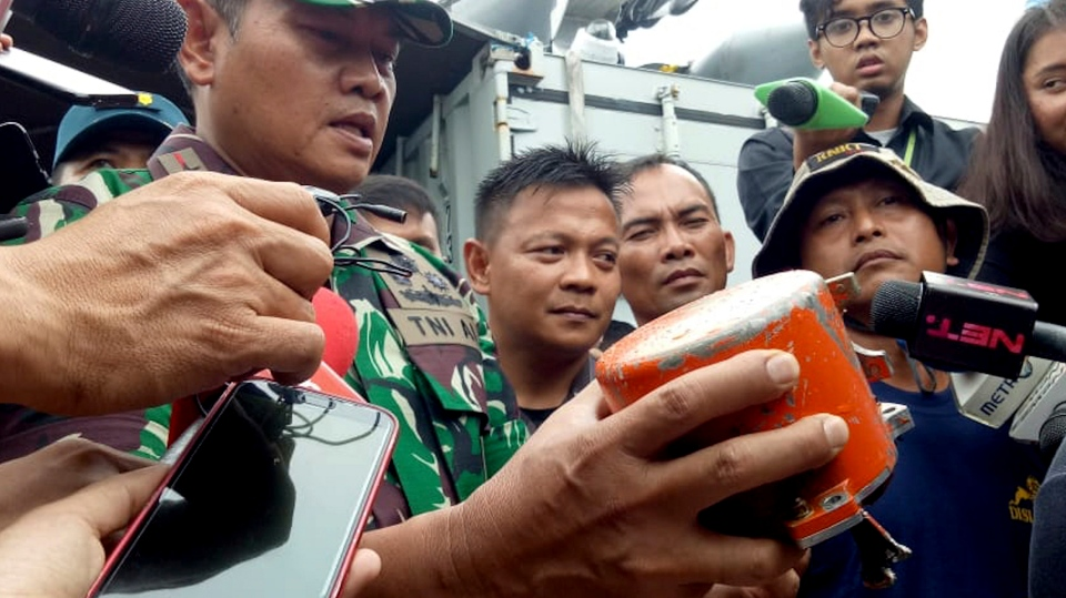 Indonesian Navy Commander Rear Admiral Yudo Margin shows the recovered cockpit voice recorder of Lion Air flight 610 that crashed into the sea in October during a press conference on board of the navy ship KRI Spica in the waters off Tanjung Karawang, Indonesia, Monday, Jan. 14, 2019. (AP Photo/Achmad Ibrahim)