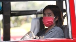 A woman wears a protective mask on bus in Bangkok, Thailand, Monday, Jan. 14, 2019. Unusually high levels of smog worsened by weather patterns are raising alarm across Asia. (AP Photo/Sakchai Lalit)