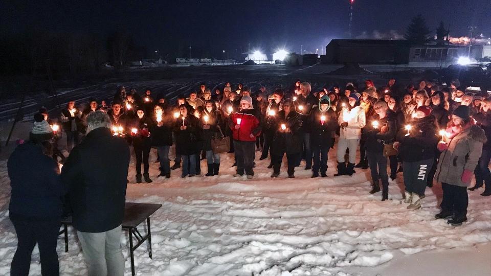 A candle light vigil is held for Kathleen Ferraz-Duchesneau in Devon, Alta., on January 13, 2019. (SEAN AMATO/CTV EDMONTON)