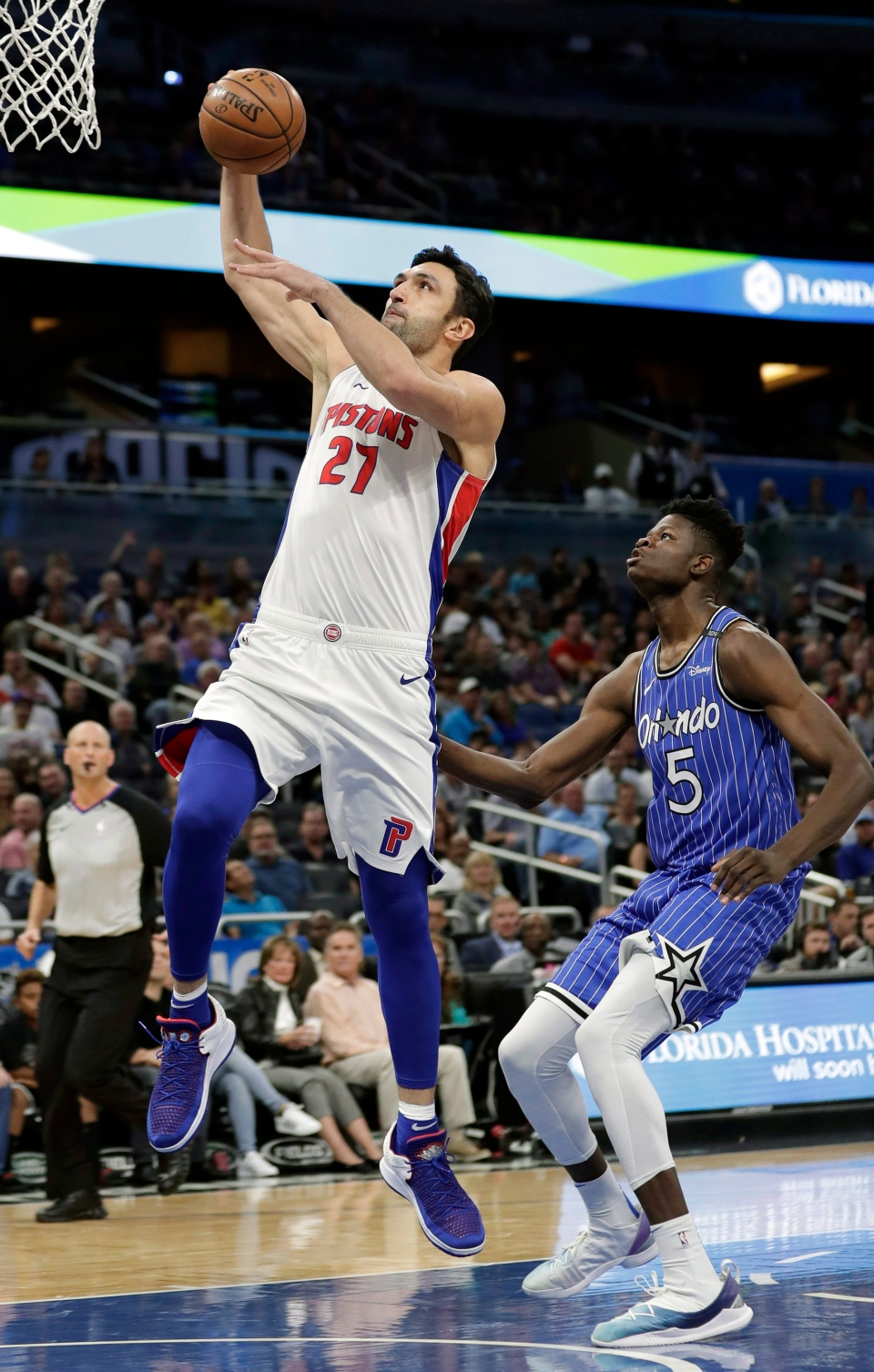 Detroit Pistons' Zaza Pachulia (27) goes past Orlando Magic's Mohamed Bamba (5) for a shot during the first half of an NBA basketball game, Wednesday, Nov. 7, 2018, in Orlando, Fla. (AP Photo/John Raoux)Special Instructions -