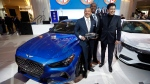 Manfred Fitzgerald, Executive Vice President & Global Brand Head of Genesis Motors, holds the trophy for the Genesis G70 winning the North American Car of the Year award during media previews for the North American International Auto Show in Detroit, Monday, Jan. 14, 2019. (AP Photo/Paul Sancya)