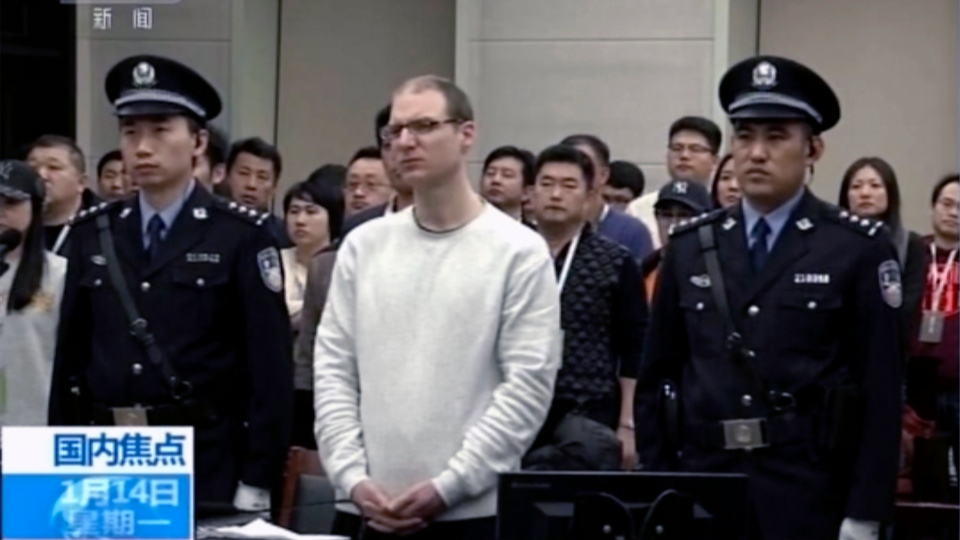 In this image taken from a video footage run by China's CCTV, Canadian Robert Lloyd Schellenberg attends his retrial at the Dalian Intermediate People's Court in Dalian, northeastern China's Liaoning province on Monday, Jan. 14, 2019. (CCTV via AP)