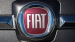 In this Oc. 21, 2018, file photo the company logo shines off the front of a vehicle at a Fiat dealership in Highlands Ranch, Colo. (AP Photo/David Zalubowski, File)