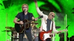 Roger Daltrey (L) and Pete Townshend of English rock band The Who perform on the Pyramid Stage at the Glastonbury Festival of Music and Performing Arts on Worthy Farm near the village of Pilton in Somerset, South West England, on June 28, 2015. (OLI SCARFF / AFP)