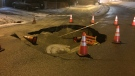 The sinkhole on Idylwyld Drive is about five feet deep and eight feet wide. (Blair Farthing/CTV Saskatoon)
