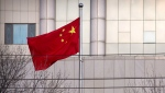A Chinese flag flies outside of the Secondary Intermediate People's Court of Tianjin northeastern China's Tianjin municipality, Wednesday, Dec. 26, 2018. (AP Photo/Mark Schiefelbein)