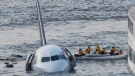 In this Jan. 15, 2009 file photo, passengers in an inflatable raft move away from an Airbus 320 US Airways aircraft that has gone down in the Hudson River in New York. (AP Photo/Bebeto Matthews)