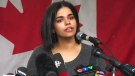 Rahaf Mohammed speaks to the media in Toronto.