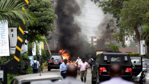 Fire and smoke rises from an explosion in Nairobi, Kenya Tuesday, Jan. 15, 2019. (AP Photo/Khalil Senosi)