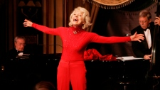 "Carol Channing performs during her one woman show,""The First 80 Years are the Hardest,"" at the cabaret Feinstein's at the Regency in New York, Oct. 18, 2005. (AP Photo/Richard Drew)"