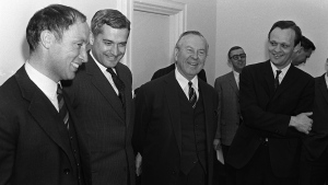 Prime Minister Lester B. Pearson (second right) and cabinet ministers Pierre Trudeau (left to right) John Turner and Jean Chretien talk in Ottawa on April 4, 1967. He was almost a decade away from becoming prime minister, but the two RCMP constables on surveillance duty that January night seemed to have no trouble recognizing Pierre Trudeau, even if they misspelled his name.THE CANADIAN PRESS/Chuck Mitchell