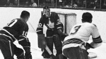 Toronto Maple Leafs' George Armstrong (left) chases after Montreal Canadiens' J.C. Tremblay in front of Maple Leafs goaltender Terry Sawchuk during playoff action in Montreal in 1966. (The Canadian Press)