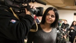 Saudi woman Rahaf Mohammed makes her way through a crowd of media after giving a public statement at the COSTI Corvetti Education Centre in Toronto, Tuesday, January 15, 2019. THE CANADIAN PRESS/ Tijana Martin
