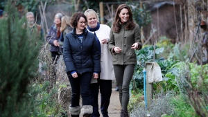 Kate, Duchess of Cambridge, right, is given a tour of the allotments as she visits the Islington community garden in north London on January 15, 2019. (Tolga Akmen/Pool via AP)