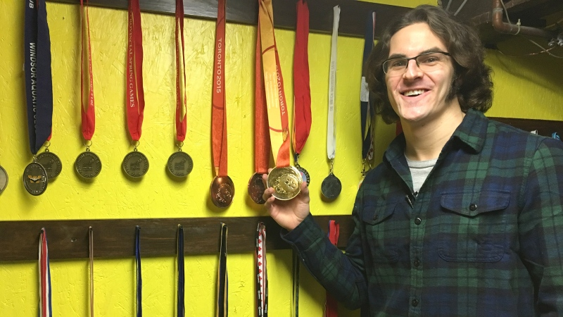 Gordie Michie shows off some of his 182 career swimming medals in St. Thomas, Ont. on Tuesday, Jan. 15, 2019. (Brent Lale / CTV London)