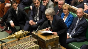 In this image issued by the House of Commons of British Prime Minister Theresa May speaks in the House of Commons in London after losing a vote on her Brexit plan Tuesday Jan. 15, 2019. (Mark Duffy, House of Commons via AP)
