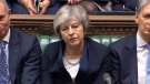 In this grab taken from video, Britain's Prime Minister Theresa May listens to Labour leader Jeremy Corbyn speaking after losing a vote on her Brexit deal, in the House of Commons, London, Tuesday Jan. 15, 2019. House of Commons/PA via AP)