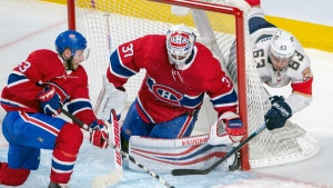 Florida Panthers right wing Evgenii Dadonov (63) is stopped on a wraparound by Montreal Canadiens goaltender Antti Niemi (37) as Montreal Canadiens defenseman Victor Mete (53) looks on during third period NHL hockey action Tuesday, January 15, 2019 in Montreal. THE CANADIAN PRESS/Ryan Remiorz