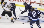 Winnipeg Jets' Josh Morrissey (44) and Jacob Trouba (8) try to stop Vegas Golden Knights' Alex Tuch (89) as goaltender Laurent Brossoit (30) gets his pad out to stop a puck late during third period NHL hockey action in Winnipeg, Tuesday, January 15, 2019. (The Canadian Press/Trevor Hagan)