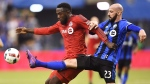 Toronto FC forward Jozy Altidore (17) battles for the ball with Montreal Impact defender Laurent Ciman (23) during first half action in the first leg of the MLS Eastern Conference final at the Olympic Stadium in Montreal on November 22, 2016. (THE CANADIAN PRESS/Ryan Remiorz)