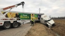 Crews remove a transport truck on Manning Road in Tecumseh, Ont., on Wednesday, Jan. 16, 2018. (John Lewis / CTV Windsor)