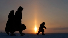 In this file photo taken on Sunday, March 15, 2015, a family is seen in the city of Nadym, in northern Siberia, Russia. (AP Photo/Dmitry Lovetsky, FILE)