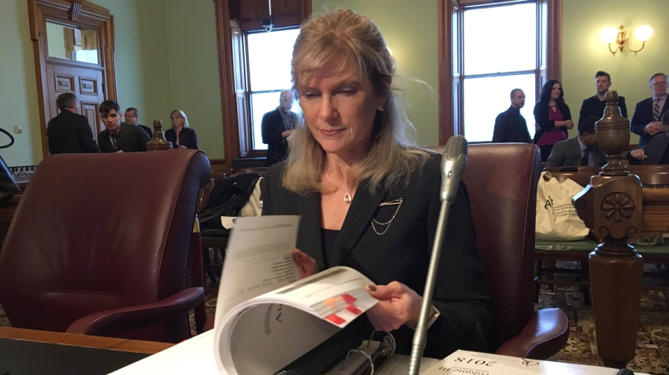 Kim Adair-MacPherson tabled two volumes of her annual report on Tuesday as she appeared before the legislature's public accounts committee. (THE CANADIAN PRESS/Kevin Bissett)