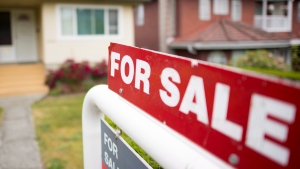 A real estate sign is pictured in Vancouver on June, 12, 2018. THE CANADIAN PRESS Jonathan Hayward